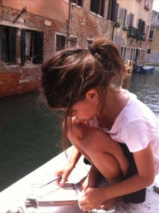 My daughter drawing leisurely in Venice