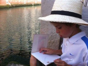 My son drawing in Venice